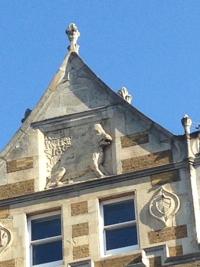 A boar insignia above a shop